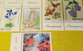Eurų monetos ir pašto ženklai